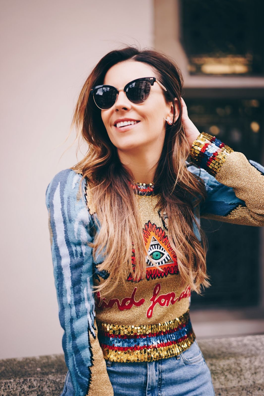 blogger juliet angus wearing gucci evil eye sweater with mih jeans and anita flavina boots