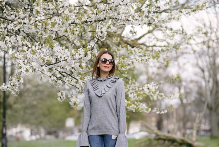 asos ruffle sweater with boyfriend jeans and theirry lasry sunglasses spring in London