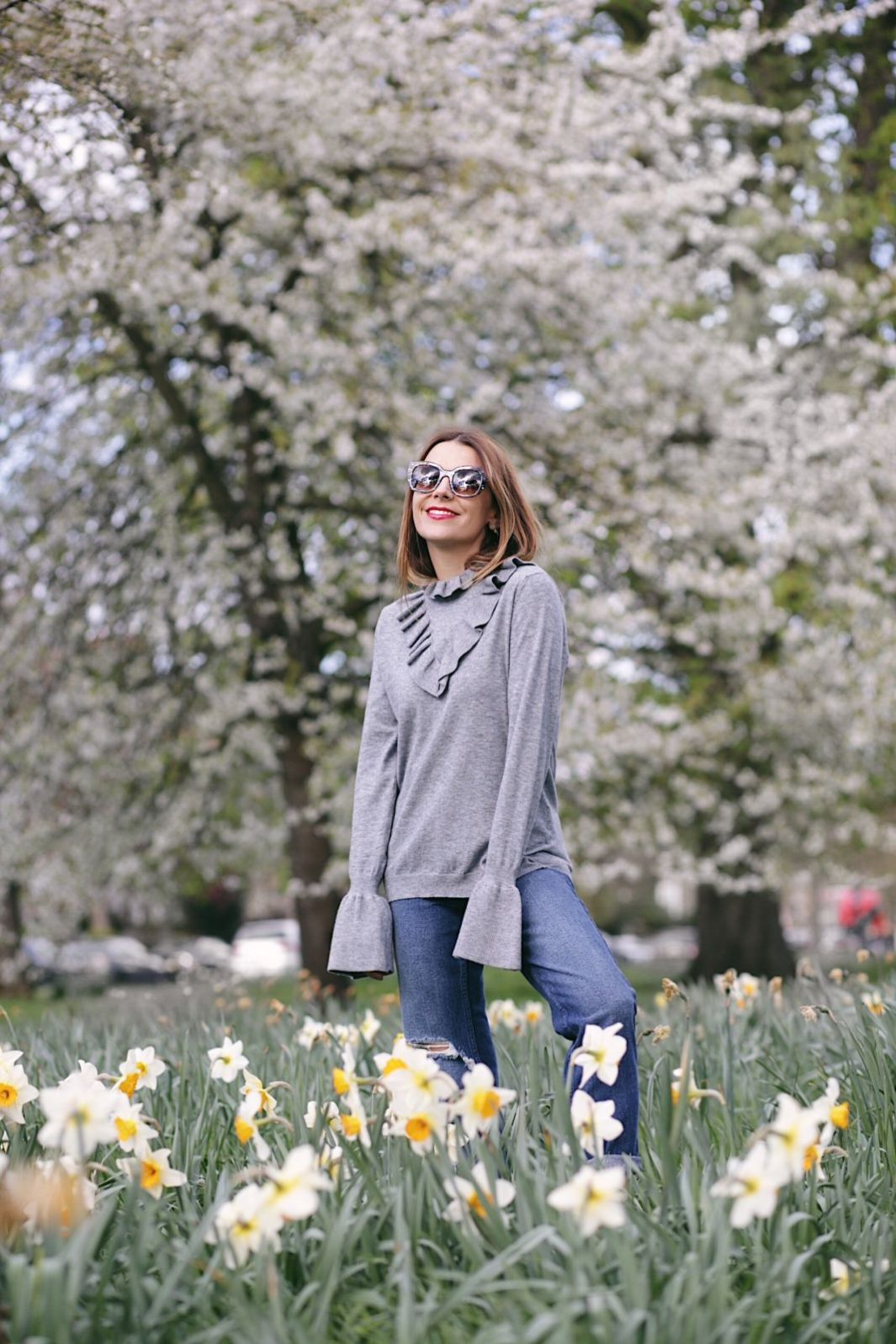asos ruffle sweater with boyfriend jeans and theirry lasry sunglasses